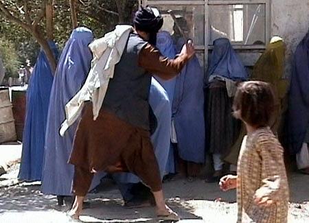 Taliban_beating_woman_in_public_RAWA