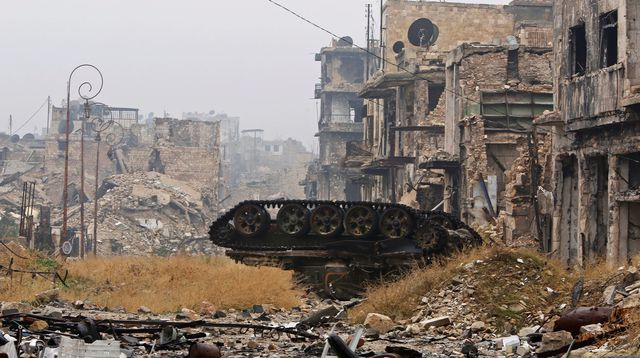 a-damaged-tank-is-pictured-amid-the-damage-near-umayyad-mosque-in-the-government-controlled-area-of-aleppo_5763943